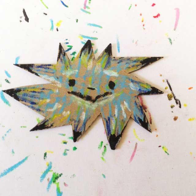 ダンボールに青い星を描く。イラスト