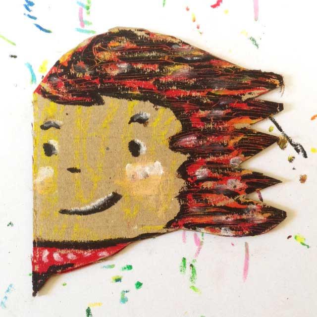 ダンボールに赤髪の人を描く。イラスト